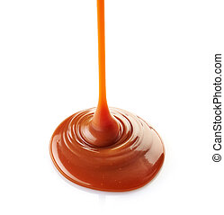 sweet caramel sauce - pouring sweet caramel sauce on a white...