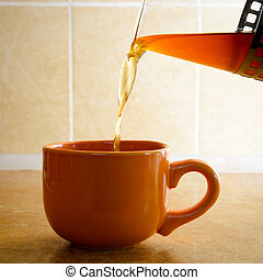 Pouring Tea in a Cup