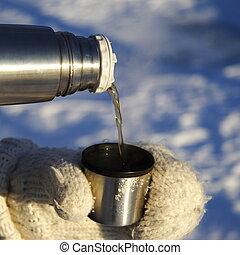 pouring tea outdoors