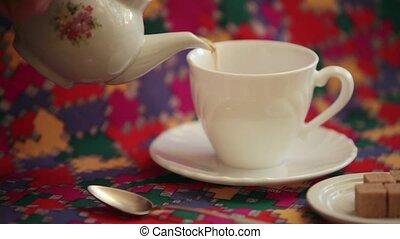 pouring tea teahouse