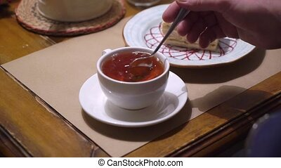 Pouring tea to cup from teapot - Pouring tea to cup from...