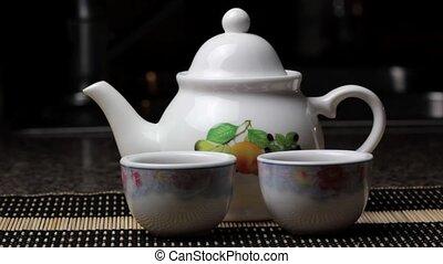 Pouring tea to teacups