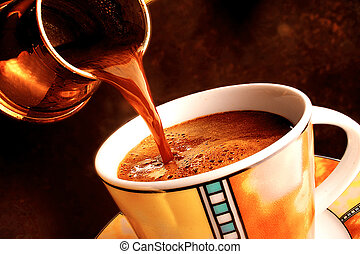 Pouring turkish coffee in a cup