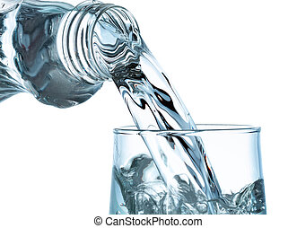 Pouring water from bottle into glass on white background
