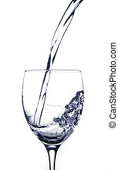 Pouring water in a glass on a white background