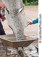 pouring wet cement to cart