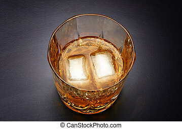 Pouring whiskey in nice glass