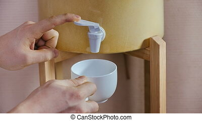 Pouring white cup with water
