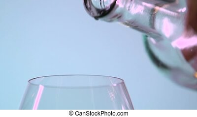 Pouring white wine drop by drop, grey, closeup, slowmotion -...