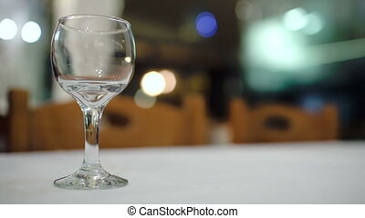 Pouring white wine into glass in restaurant