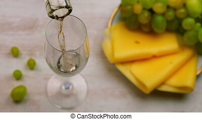 Pouring White Wine Into Glass.