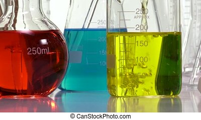 Ambiance performed with various laboratory containers on white background