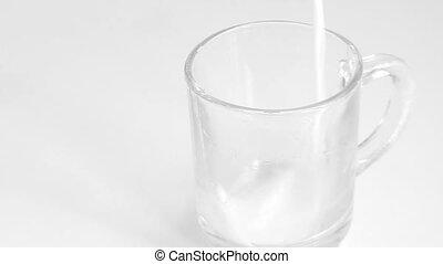 pours milk