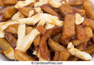 Poutine quebec meal with french fries, garvy and cheese ...