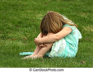 Pouty child - A pouty child in a field.