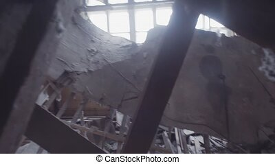 POV camera view on ruins in abandoned factory building destroyed by earthquake