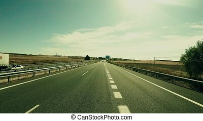POV driving shot of a highway in central Spain on a sunny summer day