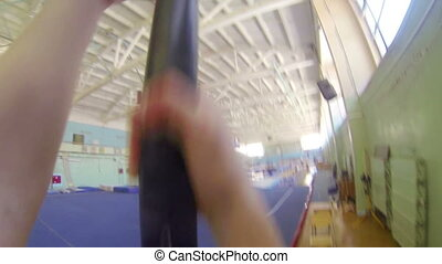 POV Gymnast climbing up on a rope at the gym