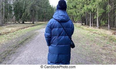POV Man chasing woman on empty footpath through pine forest, man grabbing a woman from behind.