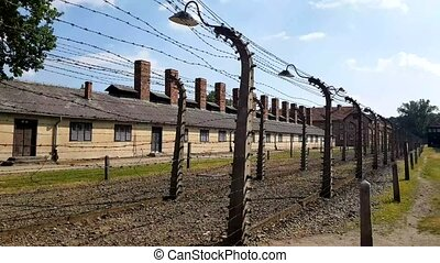 POV of barbed wire fences. Auschwitz Birkenau camp, German...
