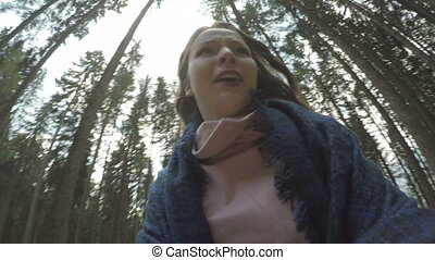 POV of chased panicked young woman running away in mountain...