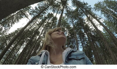 POV of eco friendly girl smiling and admiring the beauty of nature with 360 view of forest landscape in background