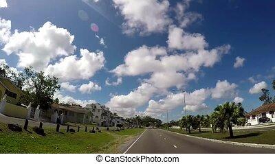 POV of Famous Bay Street neighborhood in Downtown Nassau of...