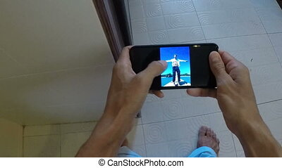 POV Of Man Sitting On Toilet Watching Photos While Angry...