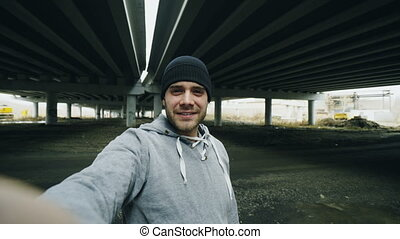 POV of sportive man having video chat on smartphone with...