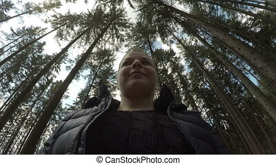 POV of teen girl walking on hike in nature through woods