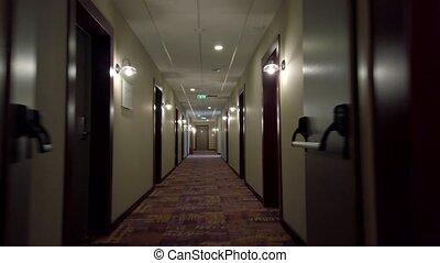 POV of walking in long corridor in a hotel