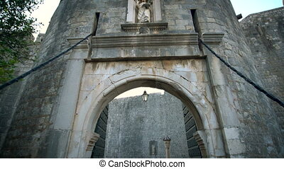 POV Tourist walk through Dubrovnik entrance gate. - POV ...