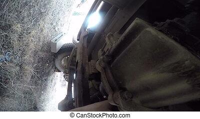 POV under car man repair propeller shaft. Stock Footage