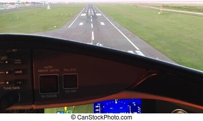POV view from a cockpit of plane approaching runway and landing
