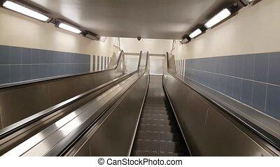 POV view moving down by escalator. Nobody