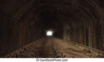Pov walking inside of old dark long abandoned tunnel with...