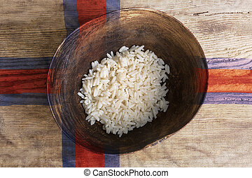 Poverty concept, bowl of rice with Faroer Islands flag