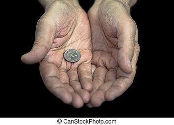 Poverty. Old hands with a single coin of 25 cents