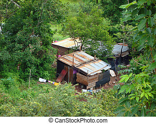 Poverty - A poor shack with a clothesline and clothes...