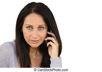 poważny, kobieta, używając, cellphone