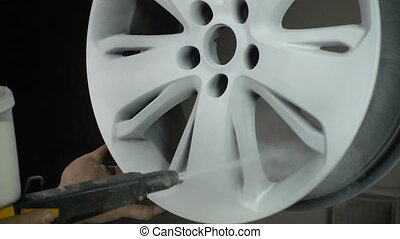 Powder coating of auto disk, slow motion in workshop