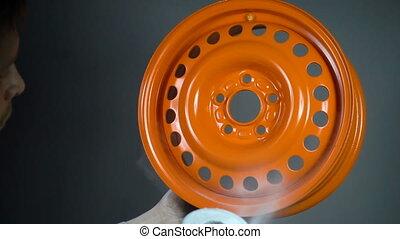Powder coating of car disk, slow motion in workshop