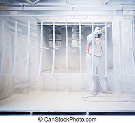 Powder coating - Worker wearing protective wear performing...