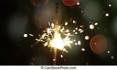 Powder sparks of Bengal lights against dark background. Slow Motion