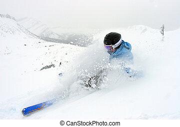 Powder - Woman skiing in deep powder