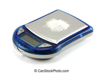 Powdered drugs (Cocaine) on scale