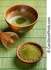 Powdered green tea on bamboo napkin texture