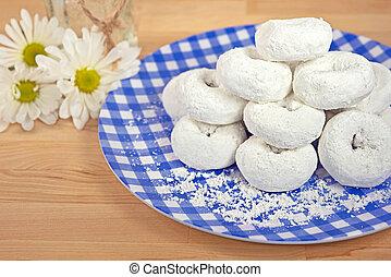 powdered sugar donuts - Pile of powdered sugar donuts on...