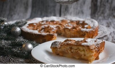 powdered sugar pours on Christmas Apple pie. High quality FullHD footage