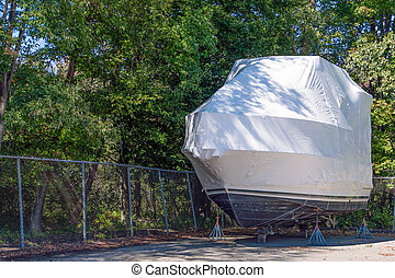 power boat with white shrink wrap - power boat on stands...
